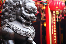 Lion Statue In Front Of Chines...