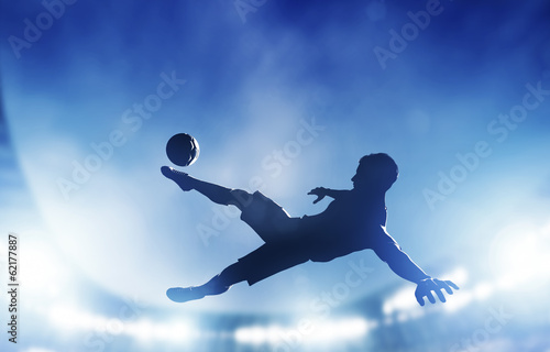 Fotografie, Tablou Football, soccer match. A player shooting on goal