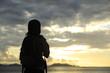 woman hiker enjoy the view at sunrise seaside