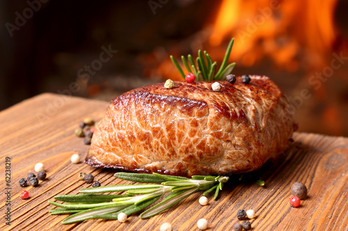 Papiers peints Steakhouse Grilled beef steak on a background of fire
