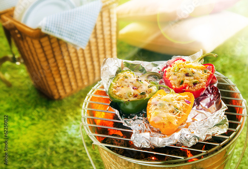Aluminium Prints Grill / Barbecue Stuffed savory sweet peppers grilling on foil