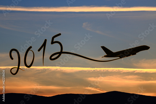 Poster  New year 2015 drawing by airplane on the air at sunset