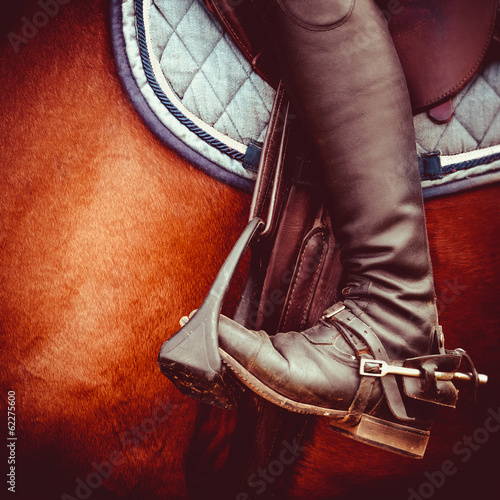 Acrylic Prints Horseback riding jockey riding boot, horses saddle and stirrup