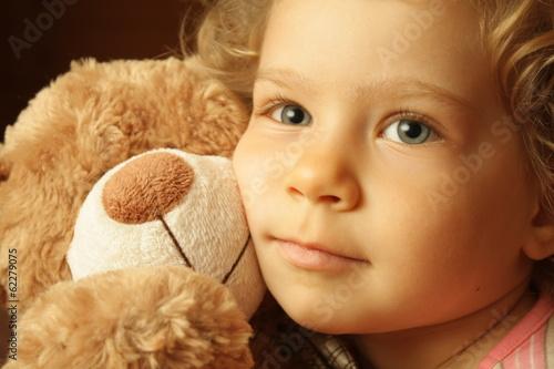 Fototapeta Child with a teddy bear obraz na płótnie