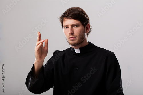 Priest is giving a blessing Canvas Print