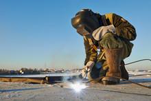 Welder At Construction Site