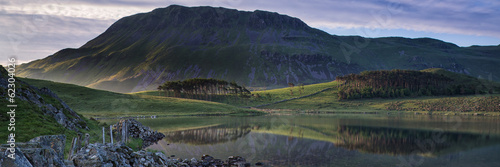 Foto auf Gartenposter Reflexion Panorama landscape stunning sunrise over lake in mountains