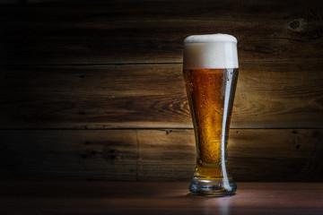 Fototapeta beer glass on a wooden background