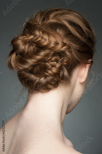 Woman with braid hairdo Fotobehang