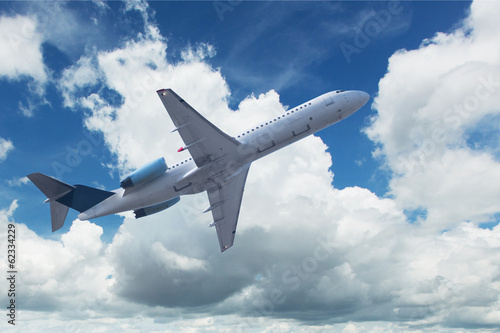 Foto op Aluminium Vliegtuig Flugzeug mit Quellwolken