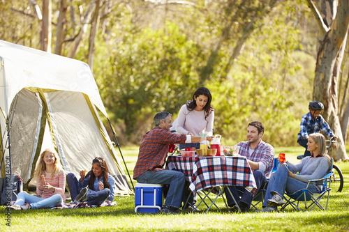 In de dag Kamperen Two Families Enjoying Camping Holiday In Countryside