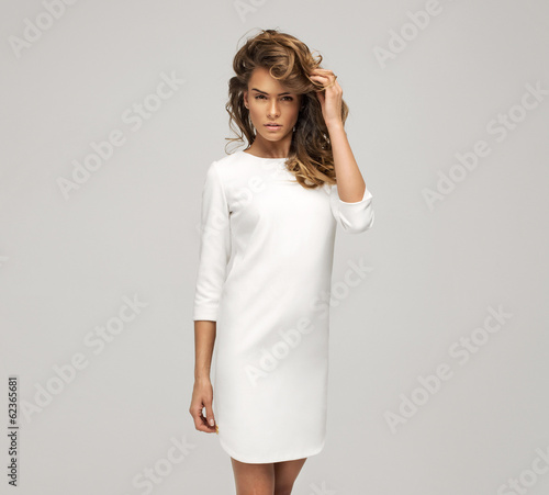 Portrait of young woman in white dress Wall mural