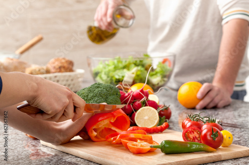 Fotografie, Obraz  Cutting a vegetables for salad
