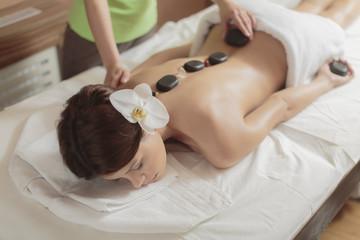 Obraz na płótnie Canvas Hot stone massage therapy