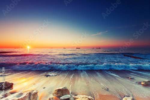 Poster de jardin Eau Sunrise over sea