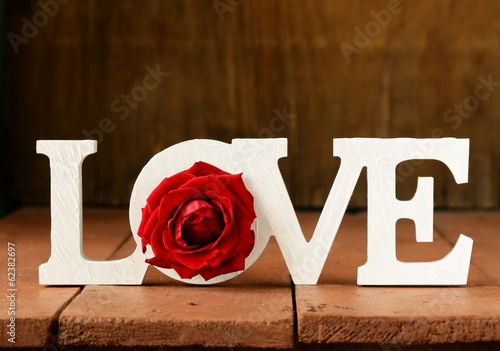 word love made of white wooden letters on wooden background