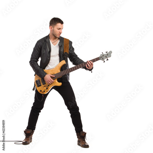 Photo  Male guitarist with bass guitar.