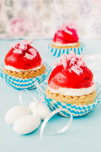 Little Cupcakes With Cream And Strawberry Glaze