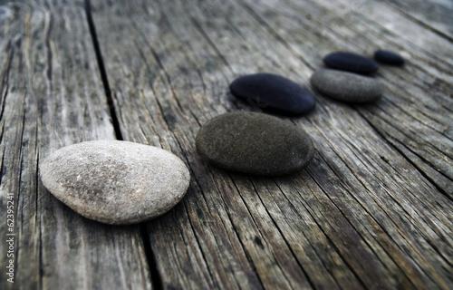 Fotografía  Smooth Pebbles on Old Wooden Pier