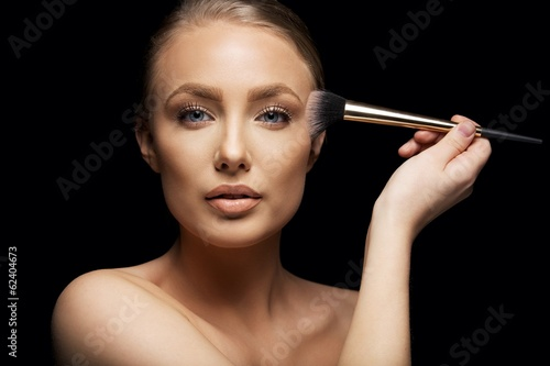 Valokuva  Beauty model applying makeup