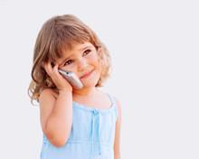 Beautiful Little Girl With Phone