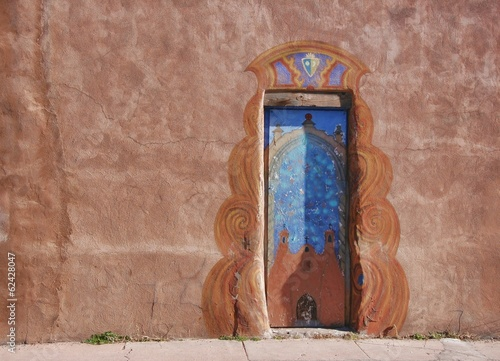 Fotografering  Weathered painted door in New Mexico