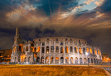 Beautiful sunset sky colors over Colosseum in Rome. Roma - Colos