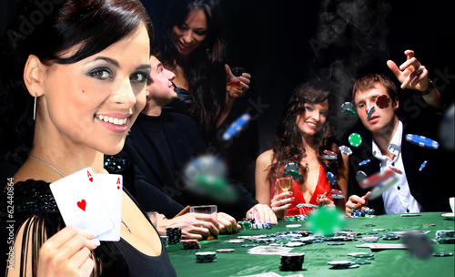фотография  Young people have a good time in casino