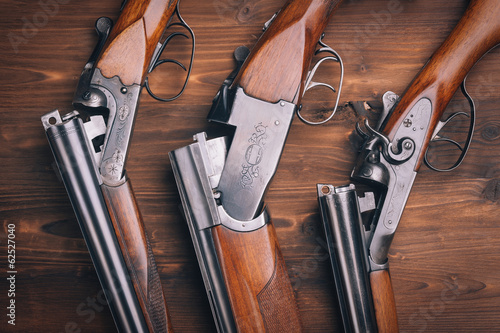 Foto Shotgun  on wooden background