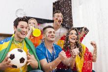 Excited Fans Of Soccer Celebra...