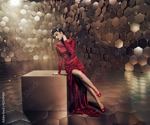 Sensual lady in shiny gold place Wall mural
