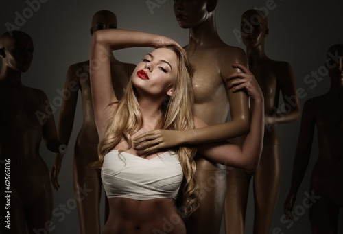 Young woman in bandage among mannequins Canvas Print