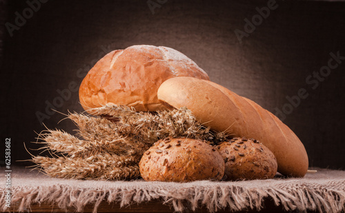 Loaf of bread and wheat ears still life