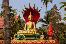 Buddha Statue Seated On Lotus Flower At Wat That Luang Tai