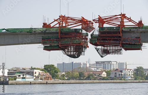 Fotografie, Obraz  Bridge construction over a river. Bangkok Thailand