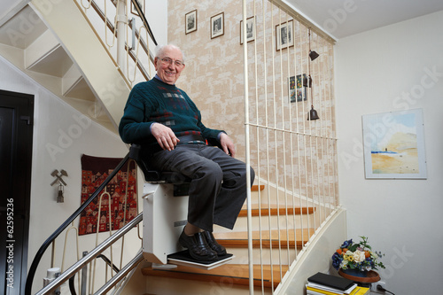 Fotomural grandfather using the stairlift