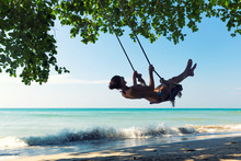 Female On Swings In Thailand