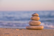 Stacked Zen stones on the beach