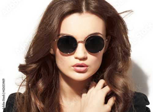 Closeup portrait of young pretty woman in summer sunny day