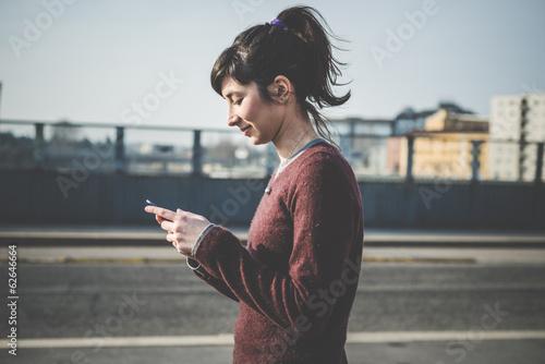 Fotografia  young beautiful hipster woman using smart phone