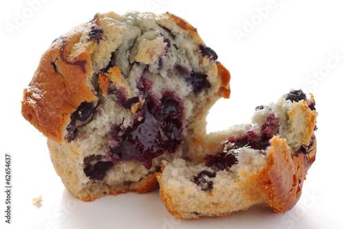 Fotografie, Obraz  Broken blueberry muffin on white surface