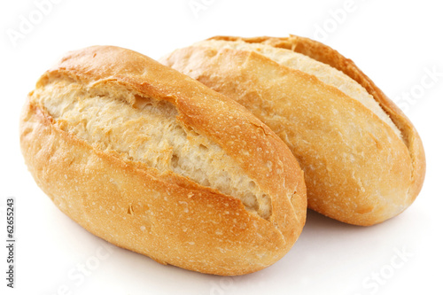 Two crusty mini baguettes on white surface Canvas-taulu