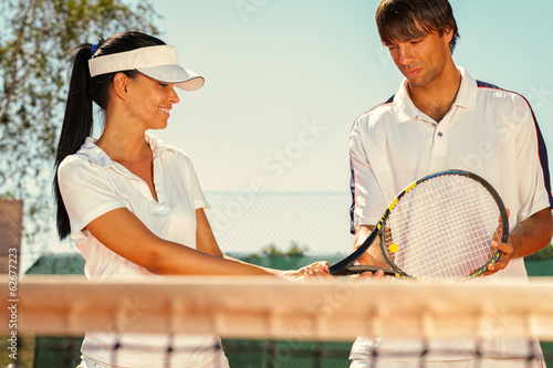 Couple of tennis players - 62677223