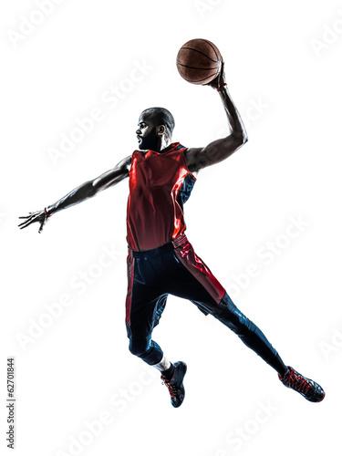 Fotografiet  african man basketball player jumping dunking silhouette