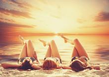 Three Girls On The Beach In Sunset.