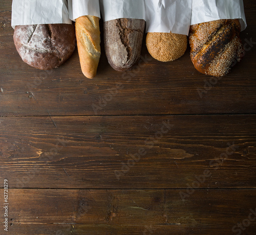 Poster Brood Fresh baked bread at wooden table