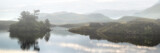 Panorama landscape view of lakein mountains with thick fog hangi - 62739827