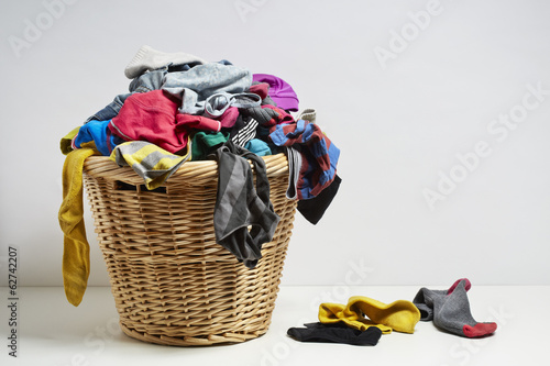 Fotografia, Obraz  Overflowing laundry basket