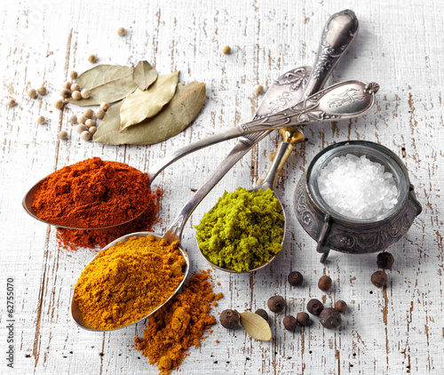 Wall Murals Spices various spices on a white background