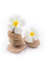 Fototapeta na wymiar isolated of the balance stones with Frangipani flower is zen for